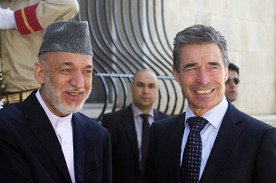 Afghan President Hamid Karzai and NATO Secretary General Anders Fogh Rasmussen (right) during the transition cermony, June 18 2013. (NATO)